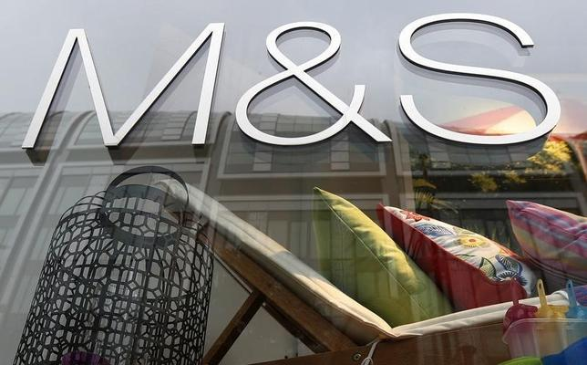 A window display is seen at a Marks & Spencer shop in central London May 21, 2013. REUTERS/Suzanne Plunkett