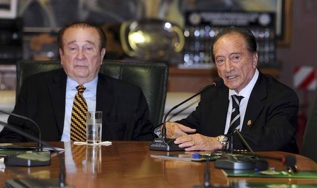 Then-acting President of the South American Soccer Federation (CONMEBOL) Eugenio Figueredo (R) speaks as his predecessor Nicolas Leoz listens during a CONMEBOL's executive committee meeting, in Asuncion April 30, 2013.  REUTERS/Stringer