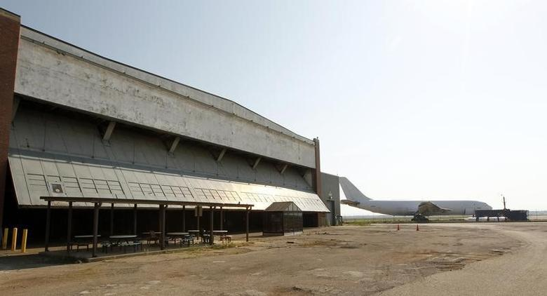 Doors that were built to accommodate airplanes are opened on the former General Motors Willow Run Powertrain plant, where RACER (Revitalizing Auto Communities Environmental Response) Trust Redevelopment held an open house, in Ypsilanti, Michigan, June 20, 2012. REUTERS/Jeff Kowalsky