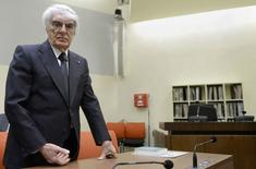 Formula One chief executive Bernie Ecclestone waits for the beginning of the session on the second day of his trial at court in Munich, May 2, 2014.  REUTERS/Christof Stache/Pool