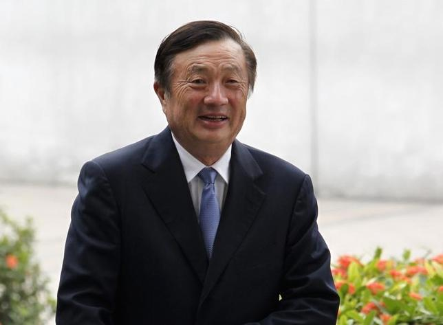 Huawei CEO and founder Ren Zhengfei walks inside Huawei's headquarters in the southern Chinese city of Shenzhen, Guangdong province, in this October 16, 2013 file photo.  REUTERS/Bobby Yip