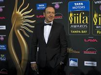 Actor Kevin Spacey walks the green carpet as he arrives for the 15th annual International Indian Film Awards in Tampa, Florida, April 26, 2014. REUTERS/Steve Nesius