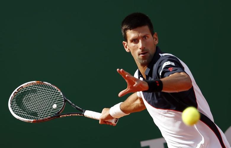 Novak Djokovic of Serbia returns the ball to Pablo Carreno-Busta of Spain during the Monte Carlo Masters in Monaco April 17, 2014. REUTERS/Eric Gaillard