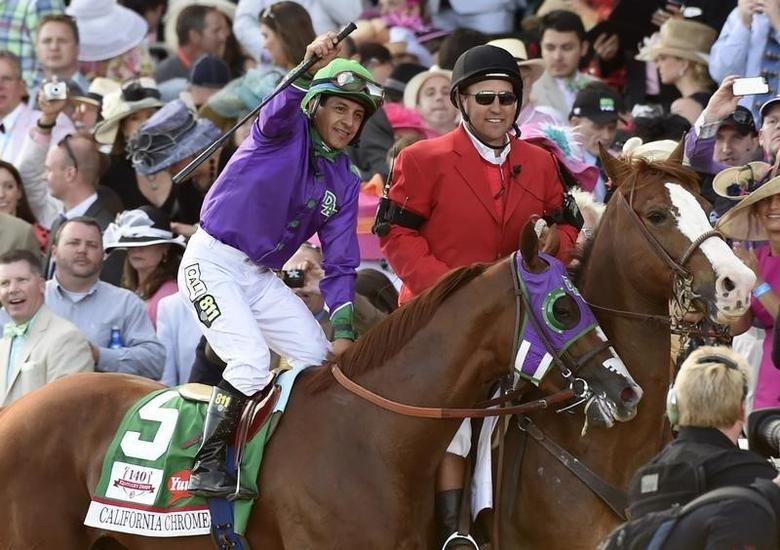 Victor Espinoza aboard California Chrome (5) celebrates after winning the 2014 Kentucky Derby at Churchill Downs. Richard Mackson-USA TODAY Sports