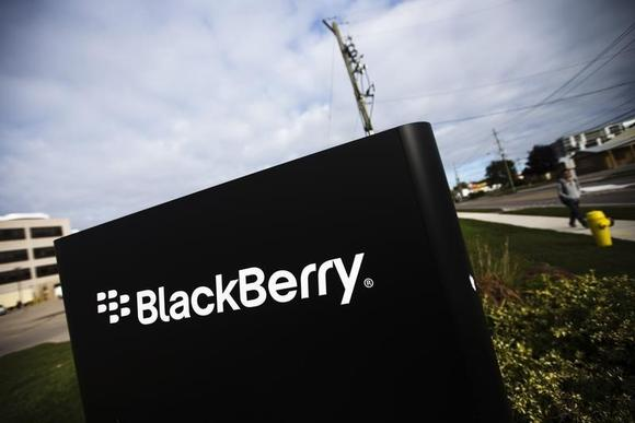 A man walks by a Blackberry sign at the Blackberry campus in Waterloo, September 23, 2013. REUTERS/Mark Blinch/Files