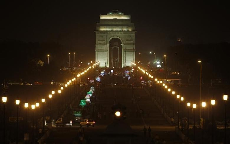 The illuminated India Gate is pictured before Earth Hour in New Delhi March 29, 2014. REUTERS/Vijay Mathur/Files