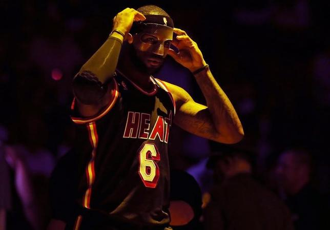 Mar 1, 2014; Miami, FL, USA; Miami Heat small forward LeBron James (6) adjusts his mask before a game against the Orlando Magic at American Airlines Arena. Robert Mayer-USA TODAY Sports