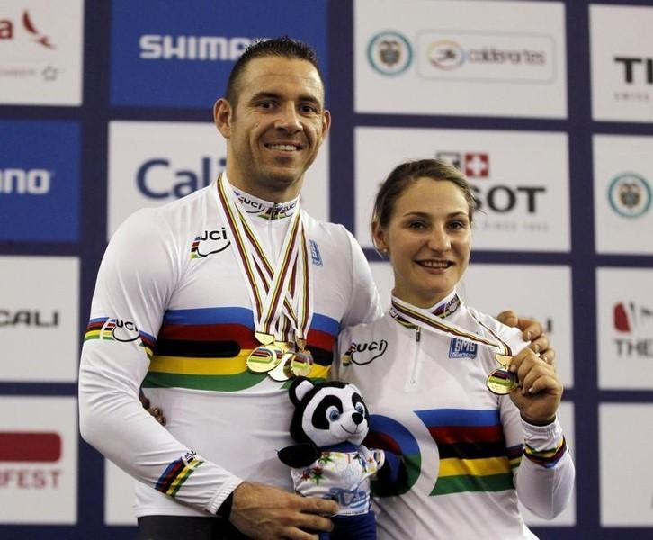 France's Francois Pervis (L) displays his three gold medals won in the Men's Time Trial, Keirin and Sprint, as Germany's Kristina Vogel displays her gold medal in the Women's Keirin, during the 2014 UCI Track Cycling World Championships in Cali March2, 2014. REUTERS/Jose Miguel Gomez