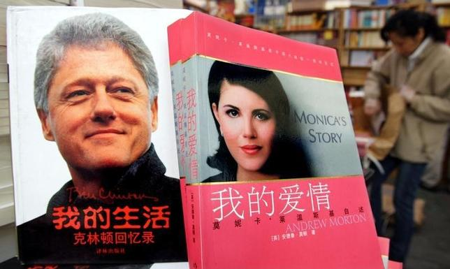 Former US president Bill Clinton's autobiography and former White House intern Monica Lewinsky's ''Monica's Story'' are displayed at a book fair in Beijing.    REUTERS/Guang Niu