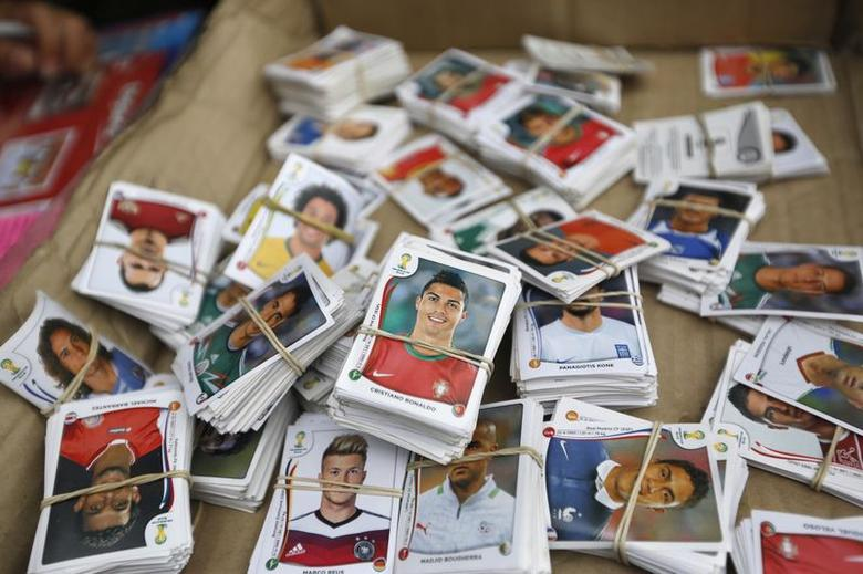 Stickers from the official 2014 FIFA World Cup sticker album are grouped to be exchanged between collectors along a street in Lima, May 1, 2014.  REUTERS/Mariana Bazo