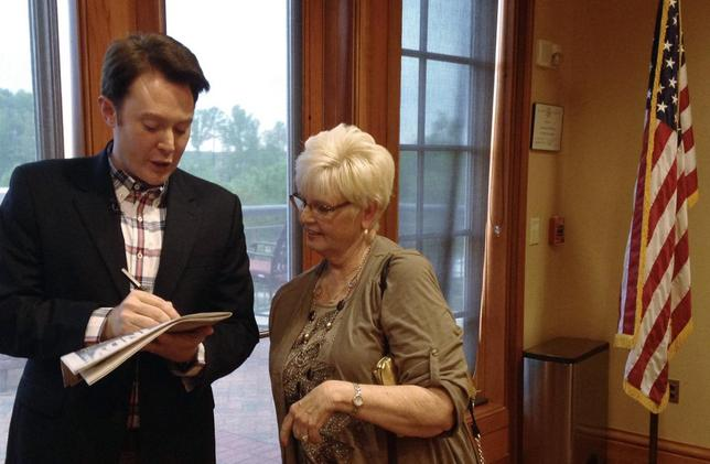 Democratic nominee Clay Aiken signs an autograph for a constituent after a campaign forum in Cary, North Carolina, April 28, 2014. REUTERS/Colleen Jenkins
