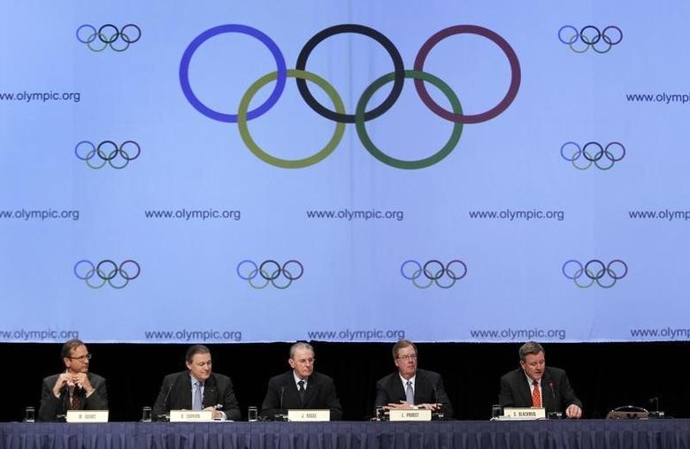 United States Olympic Committee CEO Scott Blackmun (R), United States Olympic Committee chairman Larry Probst (2nd from R), International Olympic Committee President Jacques Rogge (C) and Richard L. Carrion (2nd from L), IOC executive talk to the media during a news conference after signing an agreement during the SportAccord convention at the Congress Center in Quebec City, May 24, 2012. REUTERS/Mathieu Belanger