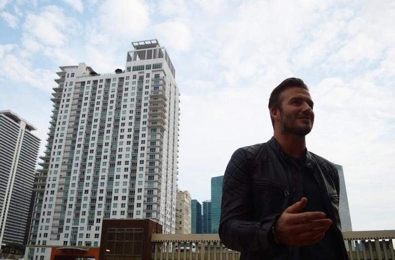 David Beckham talks to reporters at Miami Dade College in downtown Miami, March 24, 2014.   REUTERS/Zachary Fagenson