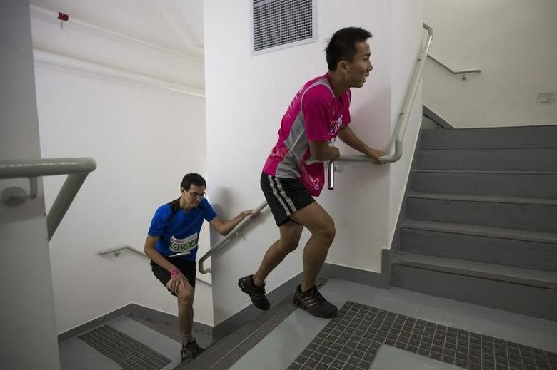 Competitors climb stairs during the SHKP Vertical Run for the Chest race in Hong Kong December 1, 2013. REUTERS/Tyrone Siu