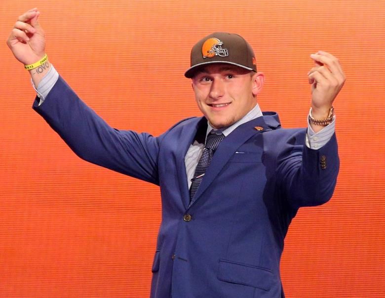 May 8, 2014; New York, NY, USA; Johnny Manziel (Texas A&M) gestures as he walks across the stage after being selected as the number twenty-two overall pick in the first round of the 2014 NFL Draft to the Cleveland Browns at Radio City Music Hall. Brad Penner-USA TODAY Sports