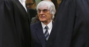 Formula One chief executive Bernie Ecclestone arrives for the third day of his trial in the regional court in Munich May 9, 2014. REUTERS/Matthias Schrader/Pool