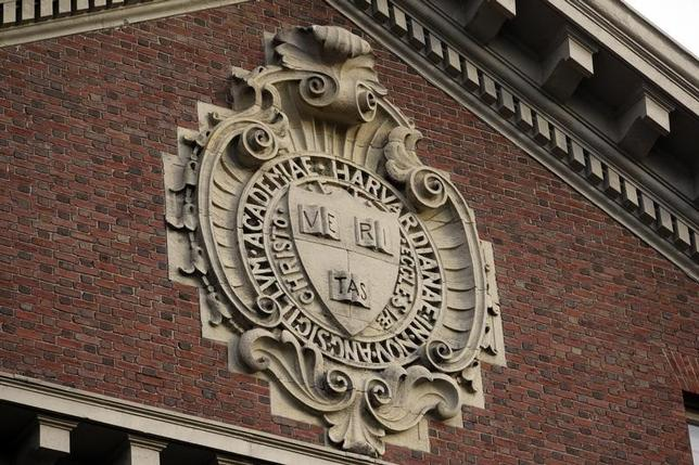 A seal hangs over a building at Harvard University in Cambridge, Massachusetts November 16, 2012. REUTERS/Jessica Rinaldi