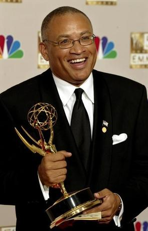 Larry Wilmore, writer for ''The Bernie Mac Show'' holds his OutstandingWriting for a comedy series Emmy at the 54th annual Emmy Awards in LosAngeles September 22, 2002. REUTERS/Mike Blake