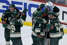 May 9, 2014; Saint Paul, MN, USA; Minnesota Wild goalie Ilya Bryzgalov (30) celebrates with forward Zach Parise (11), defenseman Ryan Suter (20) and forward Jason Pominville (29) following the game against the Chicago Blackhawks in game four of the second round of the 2014 Stanley Cup Playoffs at Xcel Energy Center. The Wild defeated the Blackhawks 4-2. Mandatory Credit: Brace Hemmelgarn-USA TODAY Sports