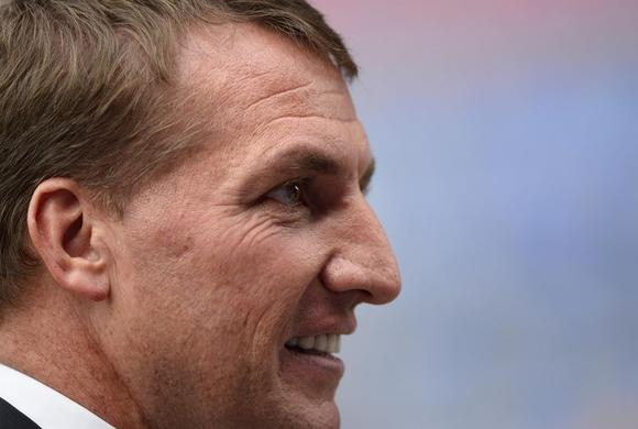 Liverpool manager Brendan Rodgers walks onto the pitch before their English Premier League soccer match against Crystal Palace at Selhurst Park in London May 5, 2014.    REUTERS/Dylan Martinez