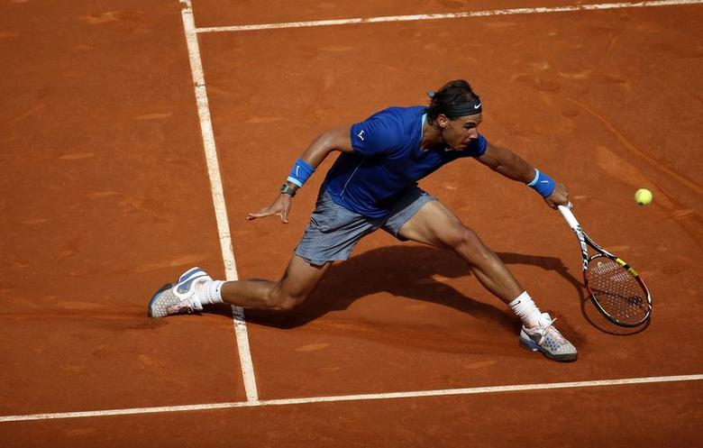 Rafael Nadal of Spain returns the ball to compatriot Roberto Bautista Agut during their men's singles semi-final match at the Madrid Open tennis tournament May 10, 2014. REUTERS/Susana Vera