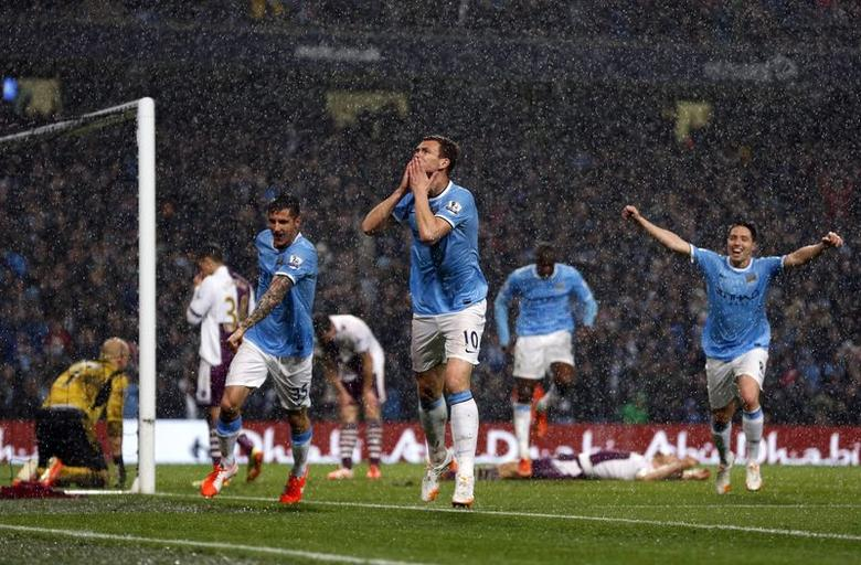 Manchester City's Edin Dzeko (C) celebrates after scoring a goal against Aston Villa during their English Premier League soccer match at the Etihad Stadium in Manchester, northern England May 7, 2014. REUTERS/Phil Noble