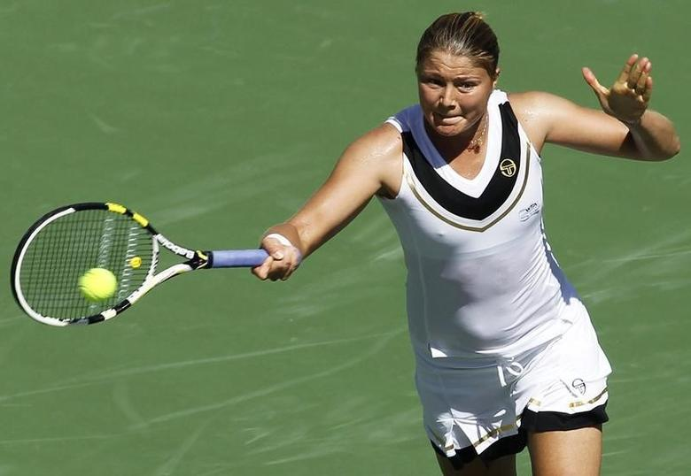Dinara Safina of Russia lunges to return a shot against Daniela Hantuchova of Slovakia during their match at the Indian Wells WTA tennis tournament in Indian Wells, California, March 12, 2011. REUTERS/Danny Moloshok