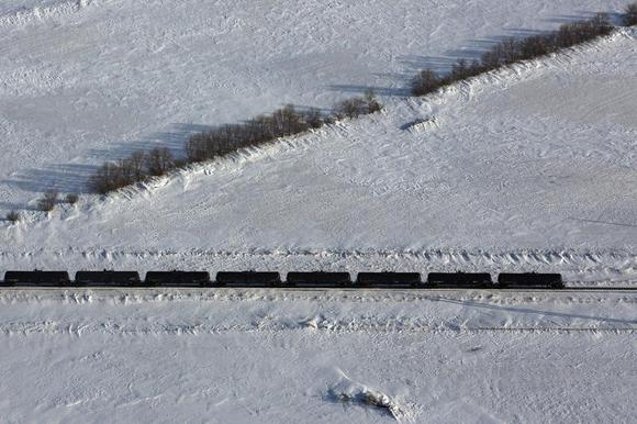 An aerial view shows a train entering a depot outside of Williston, North Dakota, March 12, 2013. CREDIT: REUTERS/SHANNON STAPLETON