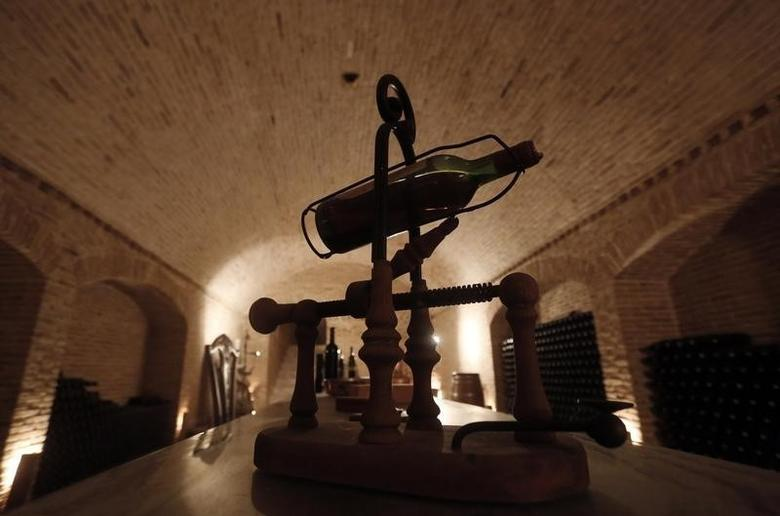 A wine bottle is seen on display in a cellar at the winery of Vassilis Panagiotou in the city of Markopoulo, east of Athens October 12, 2013.  REUTERS/John Kolesidis
