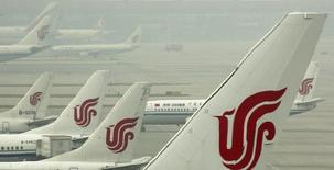Air China planes are seen on the tarmac of the Beijing Capital International Airport July 11, 2011. REUTERS/David Gray