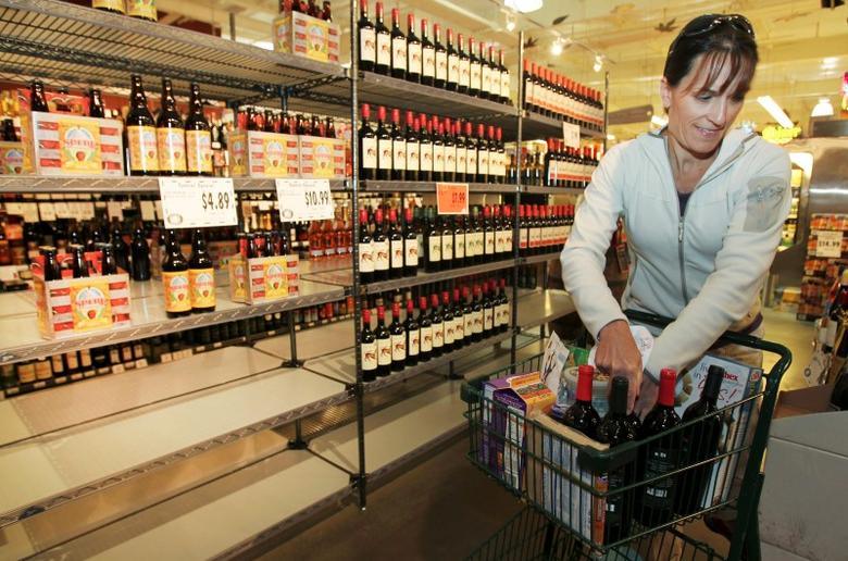 Monica Edwards shops for wine at Central Market in Shoreline, May 29, 2012. REUTERS/Anthony Bolante/Files
