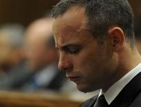 Oscar Pistorius weeps in the dock during his trial at the North Gauteng High Court in Pretoria, May 12, 2014. REUTERS/Chris Collingridge/Pool
