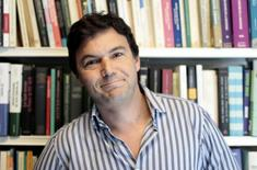 Thomas Piketty, French economist behind Socialist party candidate Francois Hollande's plan to tax all income over one million euros ($1.3 million) per year at 75 percent, poses in his office in Paris April 11, 2012.  REUTERS/Charles Platiau