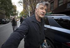 Actor Alec Baldwin shoves a photographer and tells him to move out of his way after he arrived in his SUV at the building where he lives in New York November 15, 2013.  REUTERS/Carlo Allegri