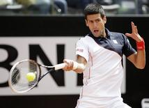 Novak Djokovic of Serbia hits a return to Radek Stepanek of Czech Republic during their men's singles match at the Rome Masters tennis tournament May 13, 2014. REUTERS/Max Rossi