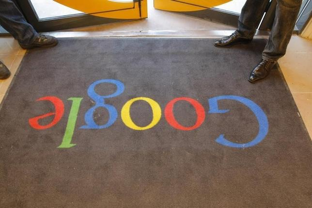 A Google carpet is seen at the entrance of the headquarters of Google France before its official inauguration in Paris December 6, 2011. REUTERS/Jacques Brinon/Pool/REUTERS