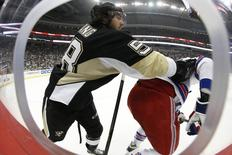 May 13, 2014; Pittsburgh, PA, USA; Pittsburgh Penguins defenseman Kris Letang (58) checks New York Rangers left wing Rick Nash (right) during the first period in game seven of the second round of the 2014 Stanley Cup Playoffs at the CONSOL Energy Center.  Charles LeClaire-USA TODAY Sports