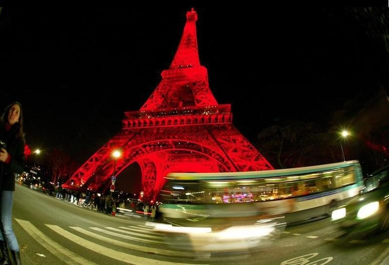 The Eiffel Tower is bathed in red light as Chinese New Year festivities kicked off in Paris, January 24, 2004. BLIFE REUTERS/Mal Langsdon