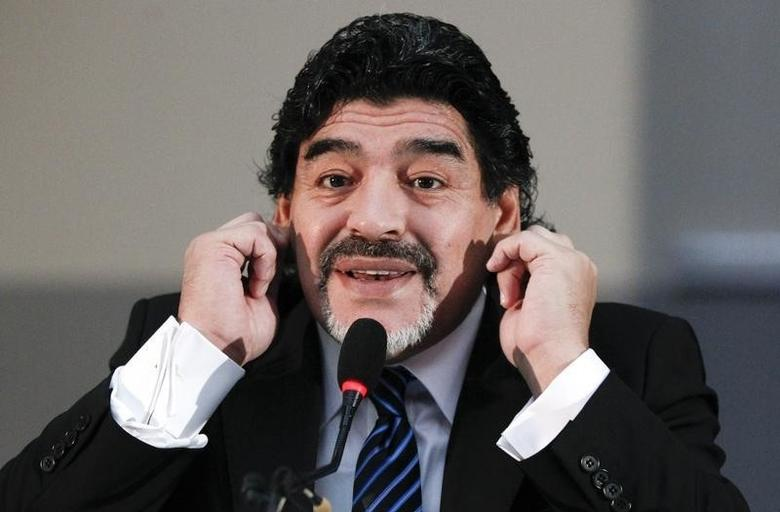 Former Argentine soccer star Diego Maradona gestures during a news conference in Naples February 26, 2013.  REUTERS/Ciro De Luca