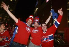 Montreal Canadiens fans celebrate following their NHL Game 7 win over the Boston Bruins in Montreal, May 14, 2014. REUTERS/Christinne Muschi