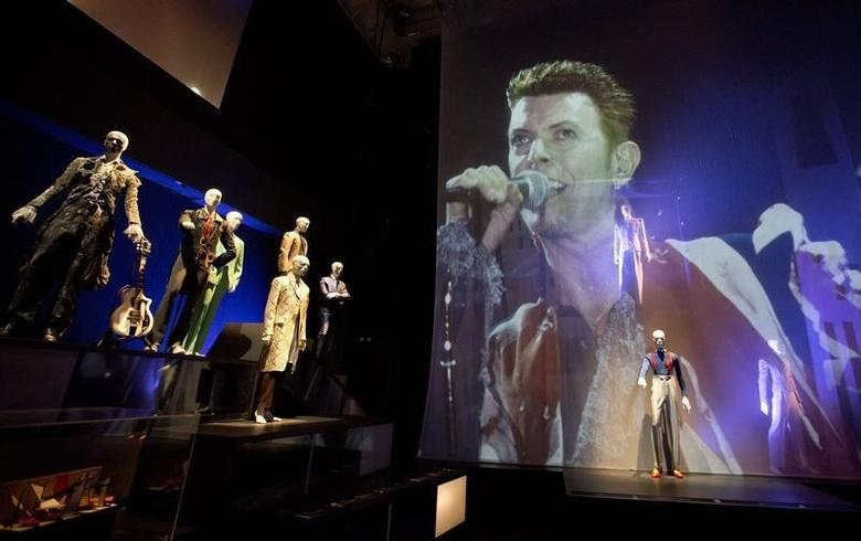 A variety of stage costumes worn by musician David Bowie are seen at the ''David Bowie is'' Exhibition at the Victoria and Albert Museum in London March 20, 2013. REUTERS/Neil Hall