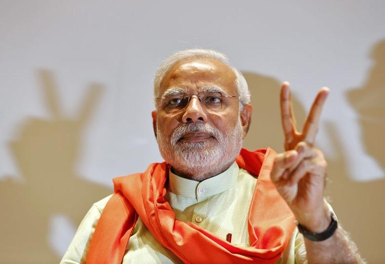 Hindu nationalist Narendra Modi, the prime ministerial candidate for Bharatiya Janata Party (BJP), gestures upon his arrival to meet his party leaders and workers at Gandhinagar in Gujarat May 13, 2014. REUTERS/Amit Dave