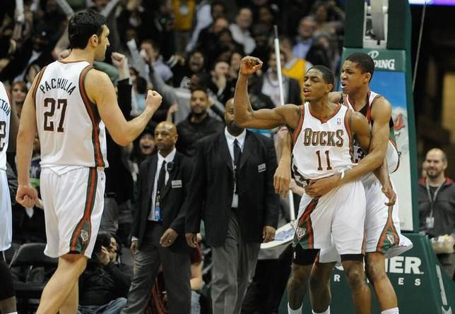 Feb 3, 2014; Milwaukee, WI, USA;  Milwaukee Bucks guard Brandon Knight (11) celebrates withy guard Giannis Antetokounmpo (34) and center Zaza Pachulia (27)  after shooting the game-winning three point basket in the final seconds against the New York Knicks at BMO Harris Bradley Center.  Mandatory Credit: Benny Sieu-USA TODAY Sports