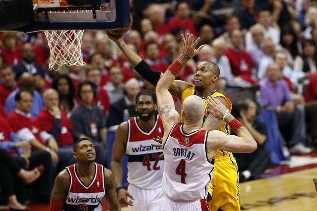 May 15, 2014; Washington, DC, USA; Indiana Pacers forward David West (21) shoots the ball over Washington Wizards center Marcin Gortat (4) in the third quarter in game six of the second round of the 2014 NBA Playoffs at Verizon Center. The Pacers won 93-80, and won the series 4-2. Mandatory Credit: Geoff Burke-USA TODAY Sports - RTR3PEDB