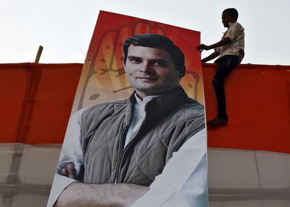 A boy holds a poster of Rahul Gandhi, Congress party's vice president and son of Congress chief Sonia Gandhi, after an election campaign rally in Kolkata May 8, 2014. REUTERS/Rupak De Chowdhuri/Files