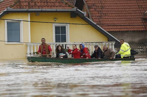 Boats pluck people from roofs as floods sweep Serbia and Bosnia