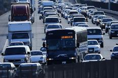 Automobile traffic backs-up as it travels  north from San Diego to Los Angeles along Interstate Highway 5 in California December 10, 2013. REUTERS/Mike Blake
