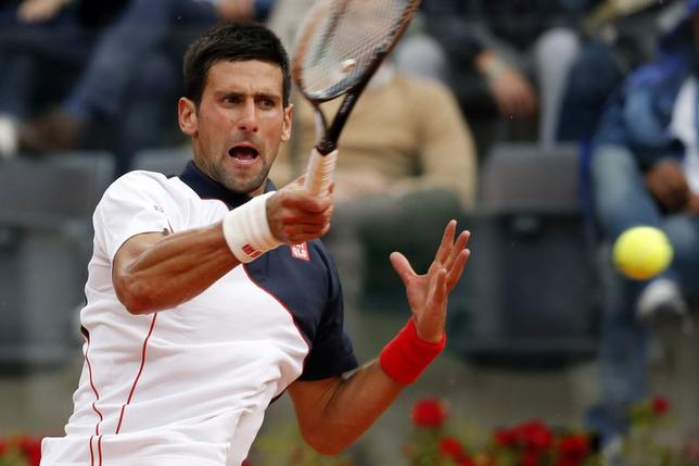 Novak Djokovic of Serbia returns the ball to David Ferrer of Spain during their men's quarter-final singles match at the Rome Masters tennis tournament May 16, 2014. REUTERS/Giampiero Sposito