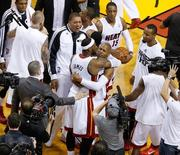May 14, 2014; Miami, FL, USA; Miami Heat forward LeBron James (6) hugs Miami Heat guard Ray Allen (34) after the Heat defeated the Brooklyn Nets in game five of the second round of the 2014 NBA Playoffs at American Airlines Arena. The Heat won 96-94. Mandatory Credit: Robert Mayer-USA TODAY Sports