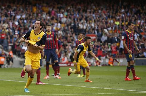 Atletico Madrid win La Liga title after draw at Barca